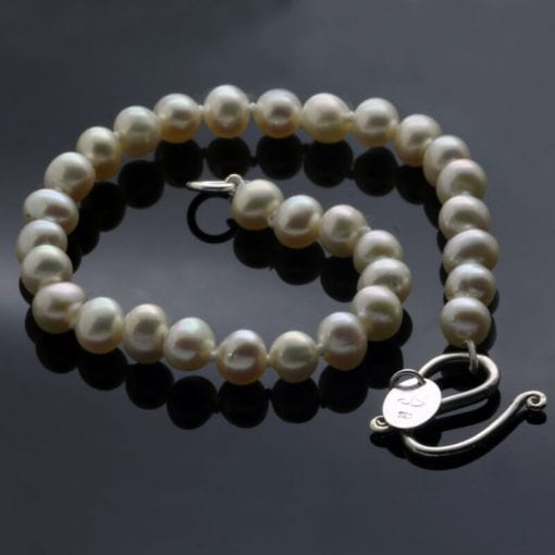 handcrafted white freshwater Pearl bracelet with Sterling Silver findings