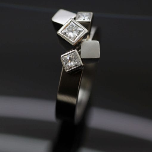 Bespoke handmade engagement ring with Princess cut Diamonds