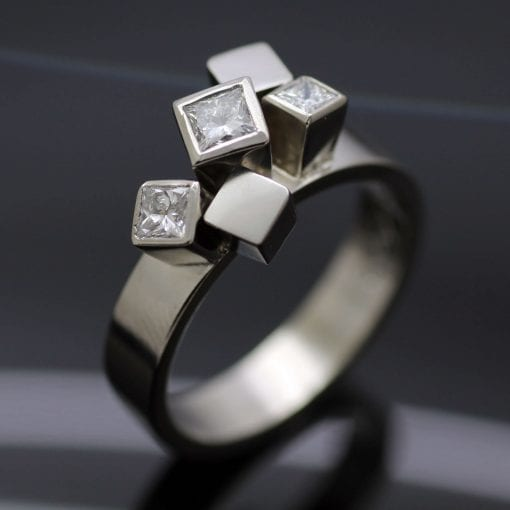 Palladium handmade bespoke engagement ring with Princess cut Diamonds