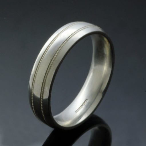 Bespoke mens wedding ring design court band lathed detail