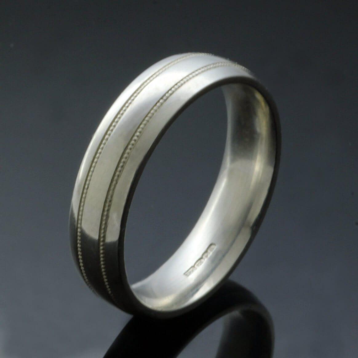 Bespoke mens wedding ring design court band lathed detail