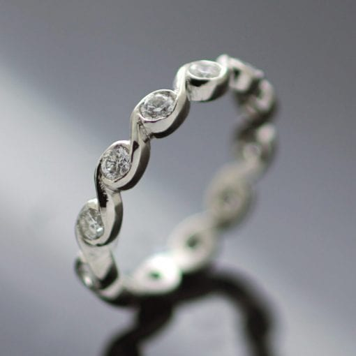 Bespoke eternity band modern wave design platinum diamonds