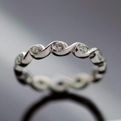 Handmade bespoke platinum diamond wave eternity band