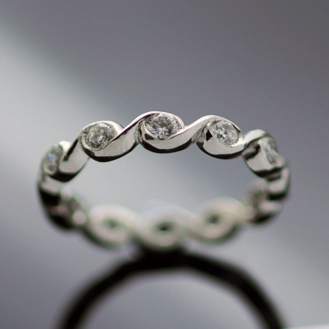 Handmade bespoke platinum diamond wave eternity band