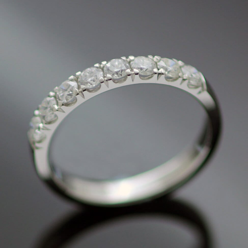 Bespoke handmade Round Brilliant Diamond Platinum half eternity band