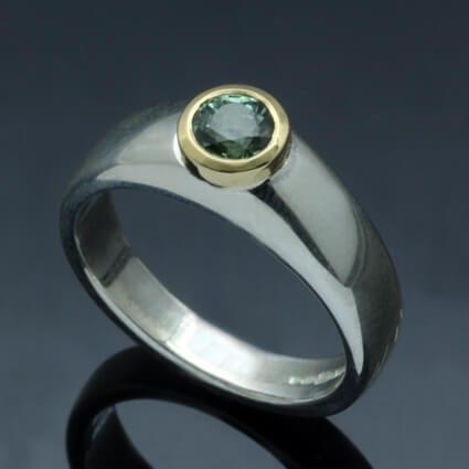 Modern handmade green sapphire yellow gold silver ring