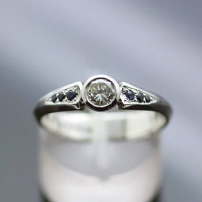 Contemporary bespoke Diamond Sapphire engagement ring handmade