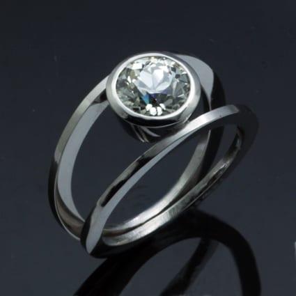 Contemporary handmade platinum round brilliant diamond ring
