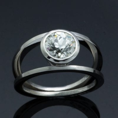 Bespoke handmade platinum round brilliant diamond ring